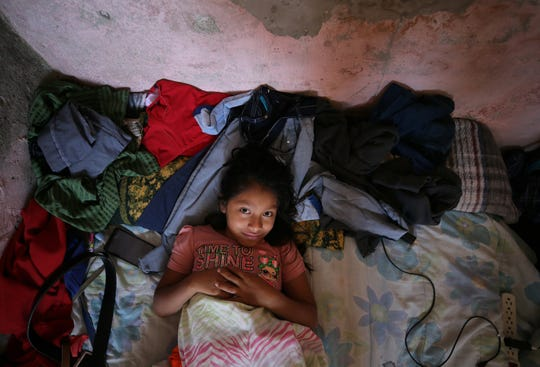 Ten-year-old Guatemalan asylum seeker Monica Sical Ramos lays on a beat up matress on the floor of a house in south-central Juarez on Monday, June, 24, 2019, where her and her father Jose Francisco Sical wait for their asylum cases. Migrants subjected to MPP are spending months in Juarez without the ability to work for months.