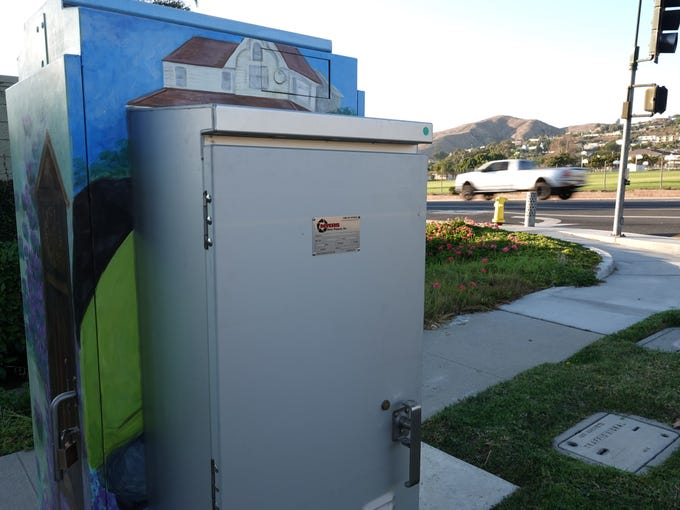 A battery pack covers a mural on a Ventura utility box painted in 2016 to honor the late Steve Cummings. The city is working with the group that commissioned the art to resolve the situation.