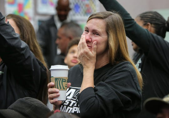 Pacifica High School campus supervisor Jennie Montgomery holds back her emotions during a board meeting at the Oxnard Union High School District office celebrating the football team's state title on Wednesday.
