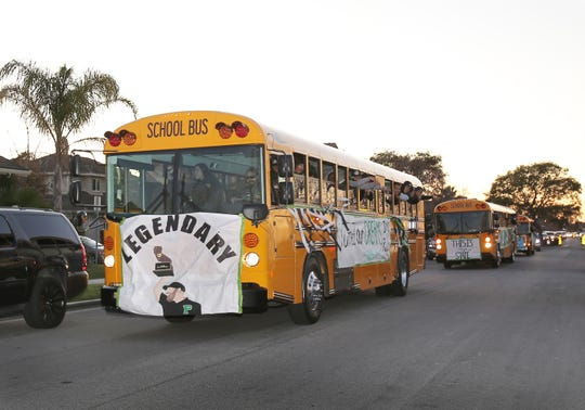 The Pacifica High football program rode in buses through Oxnard during Wednesday's parade honoring the state champion team.