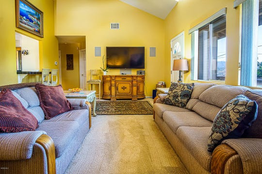 The bright yellow living room in an Oak View home, which is on the market for $717,000.
