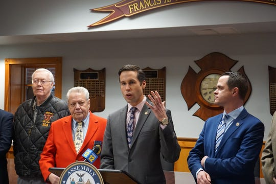Assemblyman Ken Zebrowski, center, speaks about a new state law that modernizes the school safety inspection process at a Dec. 18, 2019 press conference. Zebrowski sponsored the bill; Sen. David Carlucci, right, was the bill's Senate sponsor. They are with retired Rockland County Director of Emergency Services Gordon Wren Jr., far left, and  Jim Hartwick, of the Hudson Valley Firefighter Association.