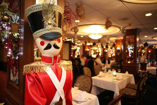 A toy soldier stands guard in front of the dining room at Mulino's  in White Plains.