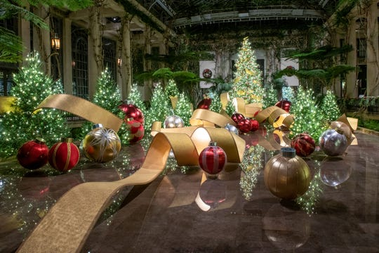 'A Longwood Christmas' includes this 350-foot ribbon made of bending Italian poplar covered on both sides with gilded wallpaper and edged with crushed walnut shells and glitter.