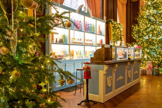 """A Longwood Christmas"" turns the music room into a sweet shop this year as an ode to childhood candy, including having the candy smell piped in."