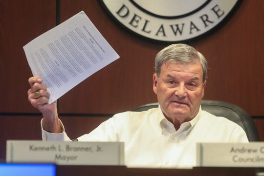 Middletown Mayor Kenneth Branner Jr. holds a copy of the soon-to-be-approved parade guidelines as the town council hears public comment on the proposals at a special meeting Wednesday. The council adopted the guidelines in response to complaints about this year's Hummers Parade with the next one set for New Year's Day in two weeks.