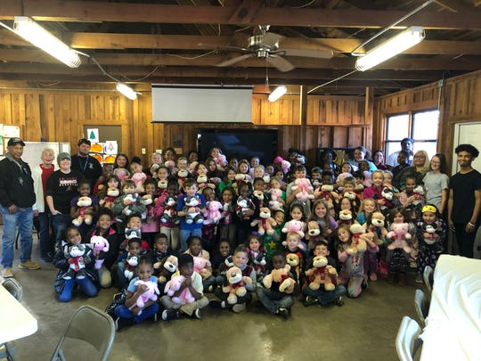 Petsmart employees made it possible for every after-school Camp Fire member to receive a stuffed animal for Christmas.