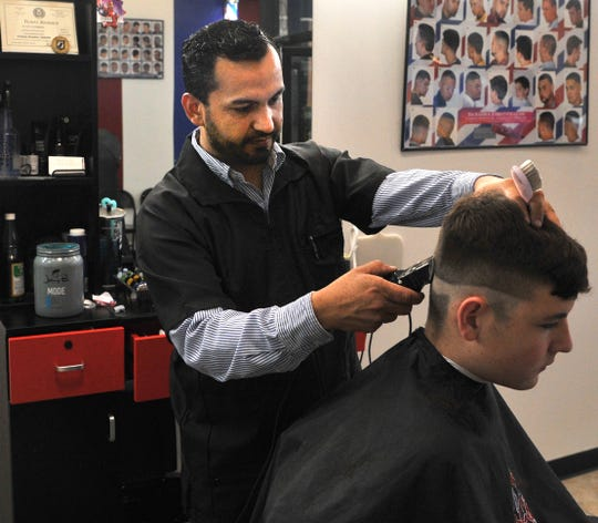 BG's Barber Shop Barber, Josue Reyes trims a customer's goatee. BG's Barber Shop owner Talia De-La-Mora said they opened their doors 3-month's ago and enjoys the friendliness Sheppard Air Force Base and Wichita Falls have given.