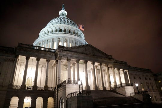 The U.S. Capitol is seen at the end of the day Wednesday, Dec. 18, 2019, in Washington, after the U.S. House voted to impeach President Donald Trump on two charges, abuse of power and obstructing Congress.