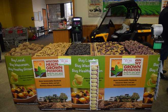 """Trig's grocery store in Rhinelander, Wisconsin, is proud of its award-winning displays such as these """"Buy Local, Buy Wisconsin"""" and """"Healthy Grown"""" bins of potatoes. """"Today's consumers want to know where their produce is grown and support our local farmers more than ever before,"""" says Don Theisen, store director."""