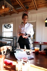 Front of house manager Kristin Crutchfield takes an order at Bistro B in Zanesville.