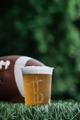 """At least 20 of the 40 postseason games in major college football list beer companies, liquor brands or casino companies as sponsors or partners on their websites, despite the fact that NCAA bowl guidelines say that associating with such companies is """"impermissible."""""""