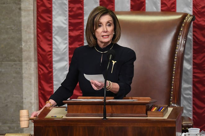US Speaker of the House Nancy Pelosi presides over Resolution 755, Articles of Impeachment Against President Donald J. Trump as the House votes at the US Capitol in Washington, DC, on December 18, 2019.