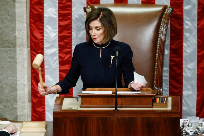 Speaker of the House Nancy Pelosi strikes the gavel after announcing the passage of article II of impeachment against President Donald Trump, Dec. 18, 2019, on Capitol Hill in Washington.