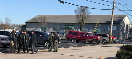 Police congregate near the site of the shooting in Westerly, Rhode Island, on Dec. 19, 2019.