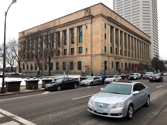 In this Monday, Dec. 16, 2019 photo, Traffic passes the federal courthouse in Columbus, Ohio. Lawyers representing human trafficking victims want a series of lawsuits alleging hotels across the country ignored signs of trafficking on their premises consolidated into a single federal case in the Columbus courthouse.