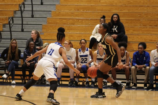 Woodmon'ts Anzya Cook (11) plays defense on T.L. Hanna's Alexis Glover.