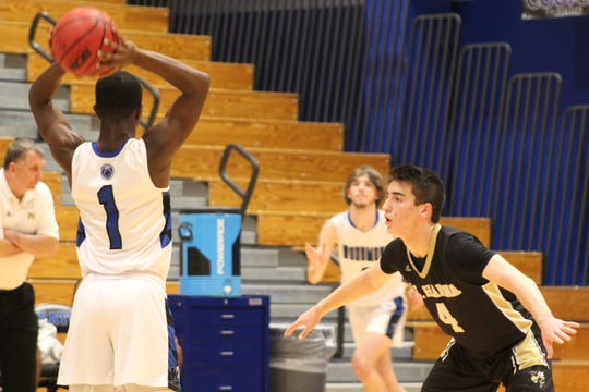 Woodmont's Braylen Wilson looks to make a pass while being defended by T.L. Hanna's James Lovorn.