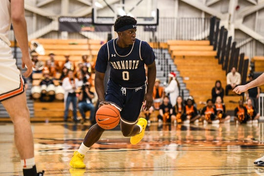 Monmouth guard Ray Salnave looks for an opening against Princeton at Jadwin Gym.