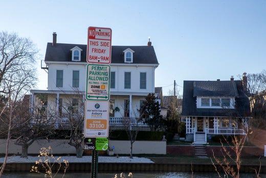 View of parking signs along Wesley Lake, overlooking Ocean Grove, in Asbury Park, NJ Friday, December 20, 2019.