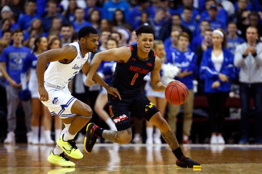 Maryland Terrapins guard Anthony Cowan Jr. (1) dribbles the ball against Seton Hall Pirates guard Anthony Nelson (2)