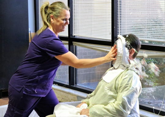 Linda Moffatt, Cardiac Cath Lab director, pies Matt Butler, Abilene Regional Medical Center CFO, this week. The fundraiser for United Way of Abilene pulled in $10,500.