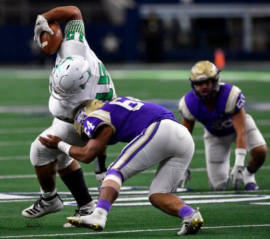 Hamlin tight end Austin Lozano breaks the attempted tackle by Mart's Tonny Sanchez during the Class 2A Div. II Championship game Dec. 19 at AT&T Stadium in Arlington. Mart won 25-20. Lozano signed with Abilene Christian University on Wednesday.