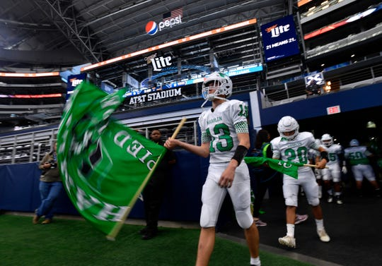 Hamlin quarterback Braydin Warner leads the Pied Pipers onto the field for their Class 2A Div. II Championship game against Mart Thursday. This was the first time in the 99-year history of the Hamlin program that the team has gone to the state title game.