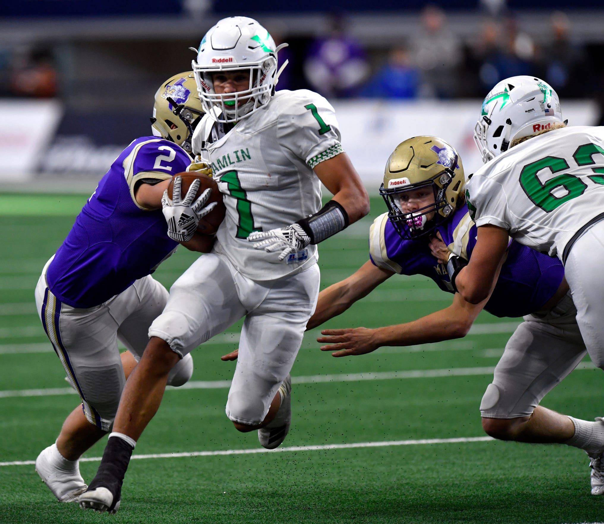 Hamlin senior Jevon Williams carries the ball against Mart during the Class 2A Div. II Championship game between Hamlin and Mart on Dec. 19. Mart won 25-20 at AT&T Stadium in Arlington.