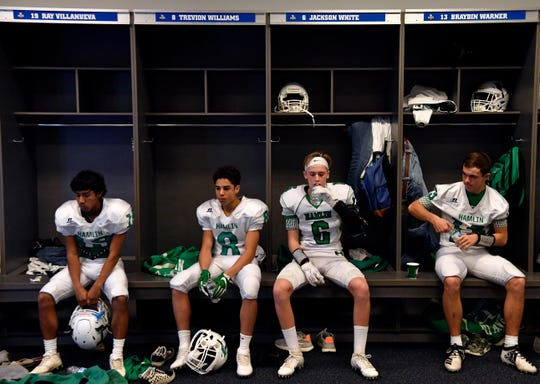 Hamlin High School football players dwell in their own thoughts before Thursday's Class 2A Div. II Championship game against Mart. The game was held at AT&T Stadium in Arlington, home of the Dallas Cowboys.