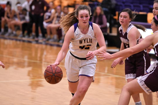 Wylie's Bailey Roberts (42) drives to the basket against Brownwood at Bulldog Gym on Friday, Dec. 20, 2019. Roberts helped lead the Lady Bulldogs 46-34 comeback win with 16 points and eight rebounds.