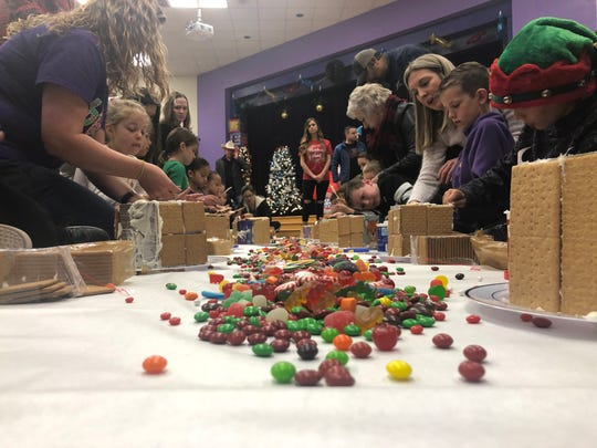 A pile of candy awaits the fingers of the builders, ready to become decorations on the gingerbread houses being built by students and parents at Wylie West Elementary School on the final day of school before the 2019-20 Christmas break Friday.