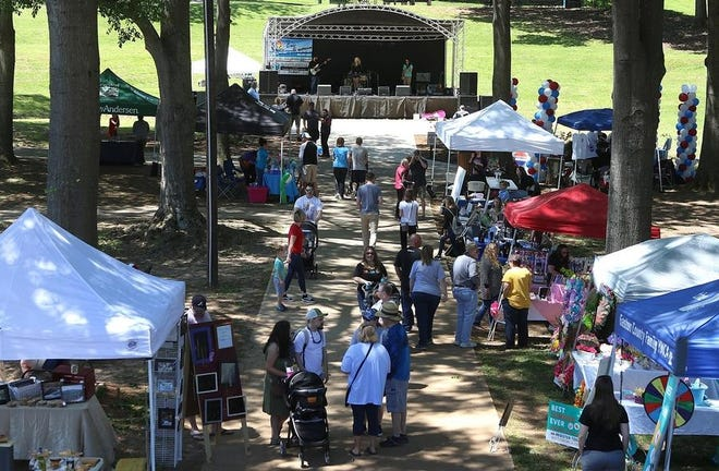 The city of Belmont in eastern Gaston County has seen its population increase exponentially in the last 10 to 20 years. Seen here are people frequenting Stowe Park, which fronts Main Avenue in downtown Belmont, during the annual Garibaldi Fest.