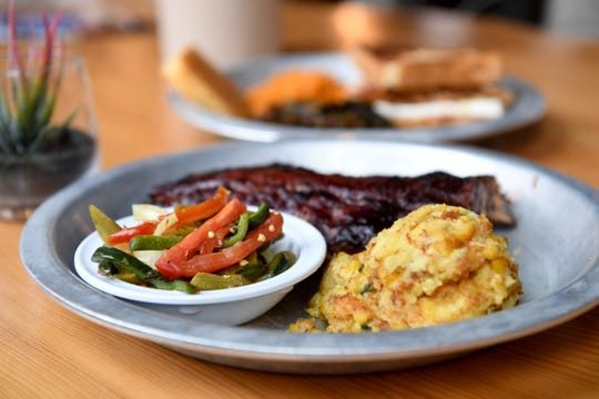 "Fried okra and ""damn good corn puddin'"" are sides served at 12 Bones Smokehouse South in Arden."