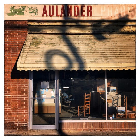 The scattered contents of the former Aulander Pharmacy are illuminated by late afternoon sunlight in the tiny Bertie County town.