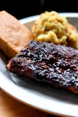 A rack of Blueberry Chipotle ribs at 12 Bones Smokehouse South in Arden is smothered in the scratch-made sauce. The smokehouse offers at least 4 different rib flavors each day.