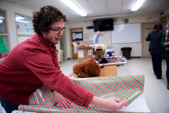 Doug Ferrall from Marshall wraps presents at Calhoun County Juvenile Home on Friday, Dec. 20, 2019 in Marshall, Mich. The Calhoun County Juvenile Home Angel Tree program collects gifts so that the children detained there will have something to open on Christmas.
