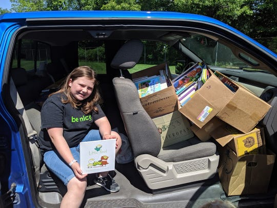In this June 2019 photo, Paige Parrott of Rockford delivers over 2,500 books to Doris Klaussen Developmental Center in Battle Creek. Parrott organized the book drive after learning the school for students with moderate to severe impairments had a new library, but very few books.