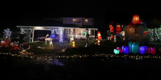 A home on Sirocco Circle in Silverdale lights up the night with holiday spirit.