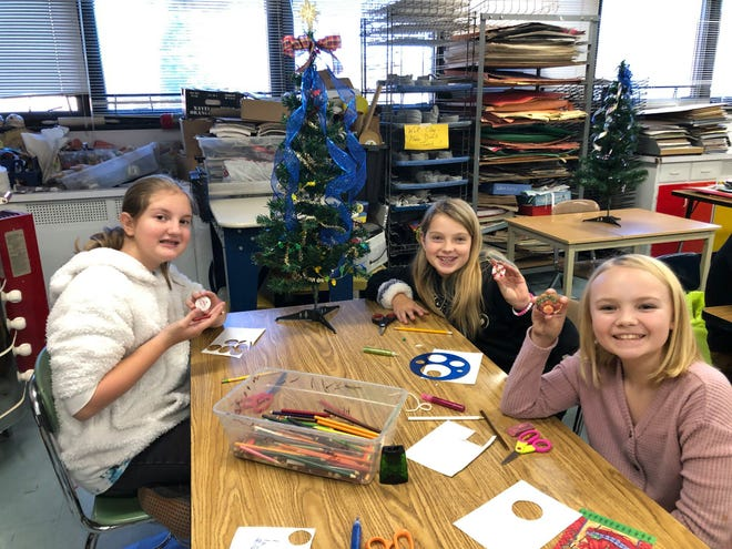 Owen Middle students decorate ornaments for the Little Trees Project.