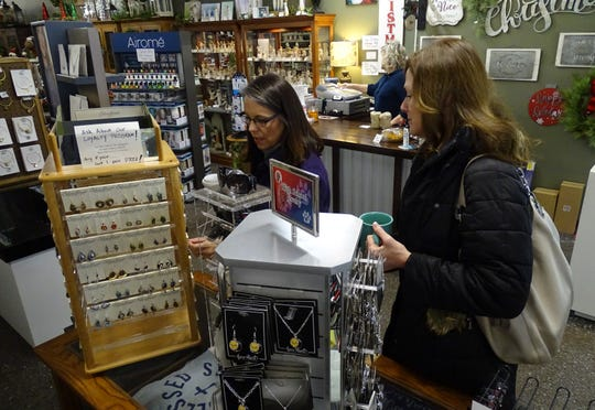 Lisa Weyant, left, and Mary Sherman explore a display at Amish Vault Fine Furniture-Graceful Gifts in downtown Bucyrus Thursday morning.
