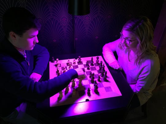 "Cameron Patterson and Jadyn Patterson of Alburgh play chess at The Clothier ""speakeasy"" bar in St. Albans on Dec. 19, 2019."