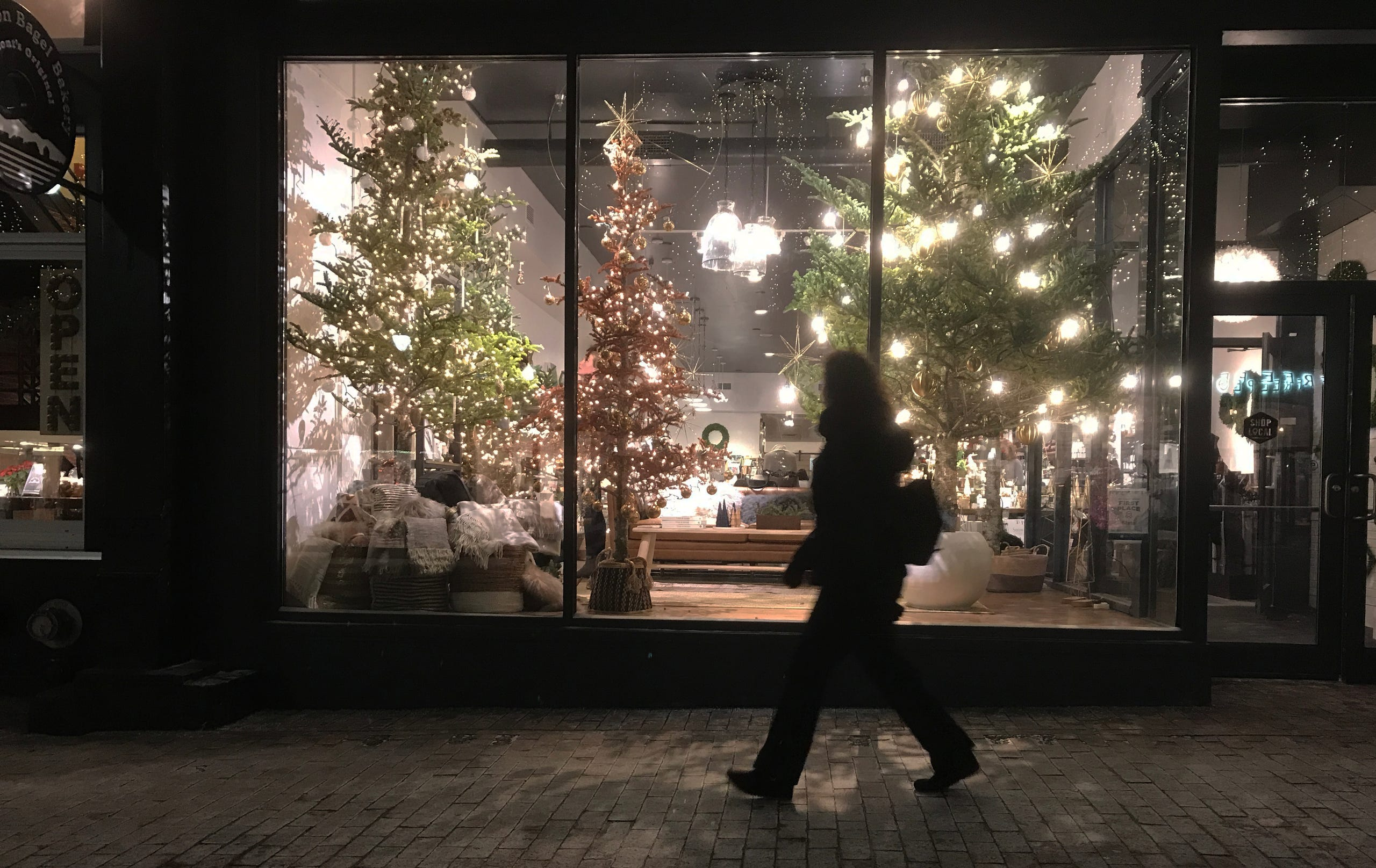 Tree-mounted lights decorate the Slate shop window on Church Street in Burlington on Dec. 19, 2019.