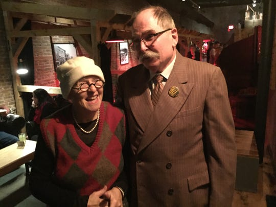 "Ann Laberge and Jonathan Hodgkin of Essex dress the part as they visit the 1920s-themed ""speakeasy"" bar The Clothier in St. Albans on Dec. 19, 2019."