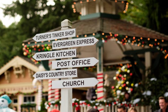 """A promotional photo for """"Christmas in Evergreen: Tidings of Joy"""" hints at the town's main landmarks."""