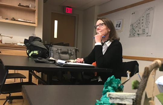 "Heather Carrington, the city of Winooski's community and economic development officer, listens to UVM student design presentations on Dec. 3, 2019. Carrington was one of several panelists who commented on the ""Finding Lost Space"" projects for David Raphael's landscape architecture class."