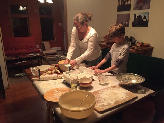 Denise Henhoeffer and my younger son, Luca Taylor, working on pierogi together  in 2017.
