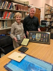 Sue Heindel of Haddonfield and brother  Steve McGraw of New York City donating  their Uncle Francis  X. McGraw 's Medal of Honor to the Smithsonian in Washington, D.C., where the medal and story of this Camden, N.J., soldier is now  featured in its National  Museum of America History.