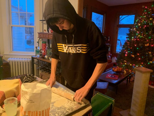 My son Jonah Taylor helps roll circles of pierogi dough to be filled with potatoes and cheese.