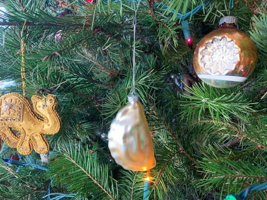 Many families hide a pickle on their Christmas tree and we have one of those too, but a particular favorite is the Golden Pierogi.